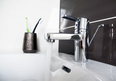 Contemporary bathroom sink detail. Clean contemporary bathroom sink detail stock photo