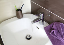 Contemporary bathroom sink. With towel stock image