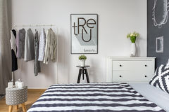 Contemporary bedroom with double bed. And clothes rack Stock Photos