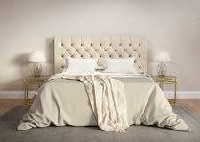 Contemporary beige bedroom with grey rug Royalty Free Stock Image