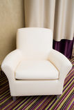 Contemporary beige comfortable armchair. Furniture Royalty Free Stock Photos