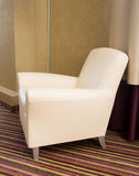 Contemporary beige comfortable armchair. Furniture Royalty Free Stock Photography