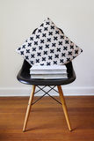 Contemporary black dining chair with modern crosses cushion. Contemporary black dining chair with modern criss cross cushion stock images