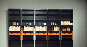 Contemporary Bookcase with Books and Ornaments. Contemporary, Modern, Orange and Black Bookcase with Books and Ornaments Royalty Free Stock Images