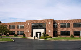 Contemporary Brick Business Building with Drive Stock Images