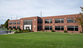 Contemporary Brick Business Building with Lawn Stock Photo