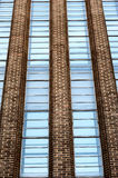 Contemporary building in London. This is a cropped image of a contemporary glass and brick building in central London showing symmetry and lines that appear to royalty free stock photo
