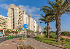 Contemporary buildings in Ashqelon, israel. ASHQELON, ISRAEL - JULY 25, 2015: Contemporary residential buildings on avenue in Ashqelon - popular tourist resort Stock Images