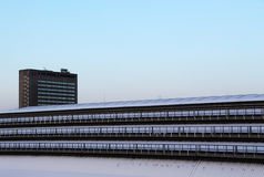 Contemporary buildings under the snow, dawn Stock Photography