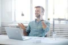 Contemporary Businessman Speaking by Phone stock photography