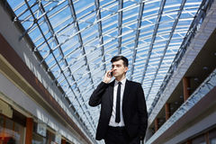 Contemporary Businessman Speaking by Phone Royalty Free Stock Images