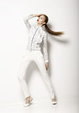Contemporary Clothing Design. Modish Woman in White Blouse and Pants. Fashion Stock Photography