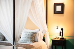 Contemporary colonial style four poster bed Stock Photo