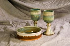 Contemporary Communion Set. 2 chalices and a plate of pottery used for communion Stock Image