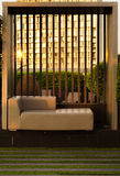 Contemporary couch on rooftop garden at sunset Stock Photo