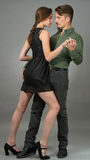 Contemporary. Couple posing in contemporary outfits Stock Photography