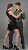Contemporary. Couple posing in contemporary outfits Royalty Free Stock Photo