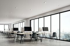 Contemporary coworking office with city view. Contemporary coworking office room interior with panoramic city view. 3D Rendering Royalty Free Stock Image