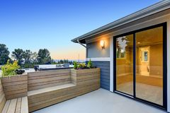 Contemporary deck with wood bench and planter boxes Royalty Free Stock Photo