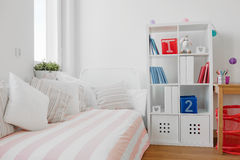 Contemporary decor of room. Contemporary decor of children room with bed and book shelf stock photos