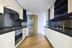 Contemporary designer kitchen. In beige and black Royalty Free Stock Images