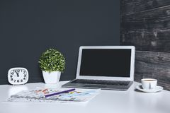 Contemporary desk top with empty laptop stock photo