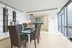 Contemporary dining area and kitchen Royalty Free Stock Image