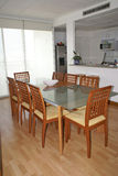 Contemporary dining room. Contemporary stylish dining room. Luminous window in the back Stock Photography