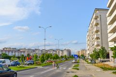 Contemporary european complex of residential buildings with new modern block buildings, green space and big boulevard Dem. Radulescu in European city Ramnicu royalty free stock images