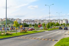 Contemporary european complex of residential buildings with new modern block buildings, green space and big boulevard Dem. Radulescu in European city Ramnicu stock photo