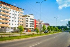 Contemporary european complex of residential buildings with new modern block buildings, green space and big boulevard Dem. Radulescu in European city Ramnicu stock image