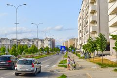 Contemporary european complex of residential buildings with new modern block buildings, green space and big boulevard Dem. Radulescu in European city Ramnicu stock photography