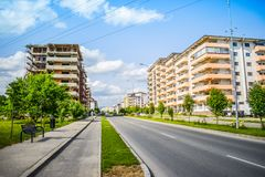 Contemporary european complex of residential buildings with new modern block buildings, green space and big boulevard Dem. Radulescu in European city Ramnicu royalty free stock image