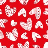 Contemporary funky stencil effect white hearts seamless vector pattern on red background stock photo