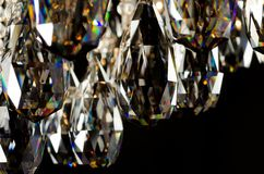 Contemporary glass chandelier crystals closeup Royalty Free Stock Photos