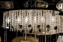 Contemporary glass chandelier isolated over black background Royalty Free Stock Image