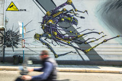 Contemporary graffiti art on city walls. Royalty Free Stock Photo