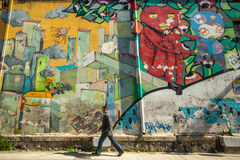 Contemporary graffiti art on city walls. Stock Images