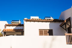 Contemporary hot water panels on a house. Solar heater for green energy. Contemporary hot water panels on a house Royalty Free Stock Images