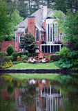 Contemporary House. A luxury home on a lake in the suburbs Royalty Free Stock Photo