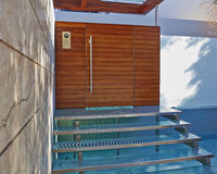 Contemporary house entrance with water pool Stock Photos