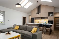 Contemporary house - living-room connected with kitchen royalty free stock photography