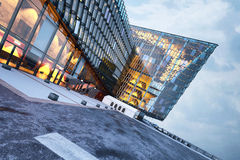 Contemporary illuminated glass building exterior Stock Photo