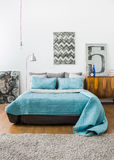 Contemporary interior with comfortable bed Royalty Free Stock Photos