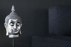 Contemporary interior design detail. With buddha image and sofa couch Royalty Free Stock Images
