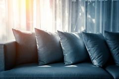 Contemporary interior of Living room with part of sofa. In sunny day and white curtain interior background concept royalty free stock photos