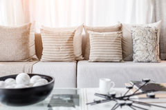 Contemporary interior of Living room with part of sofa in sunny. Day and white curtain interior background concept stock photography