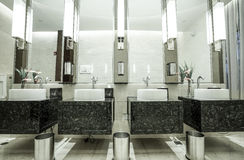 Contemporary interior of public toilet Stock Images