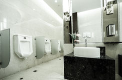 Contemporary interior of public toilet Stock Photos