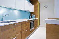 Contemporary kitchen. Colorful contemporary kitchen with modern electric appliances Stock Photos